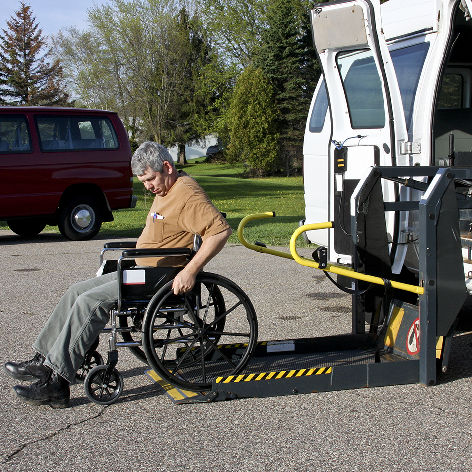 An STC driver helps a passenger using the wheelchair lift.