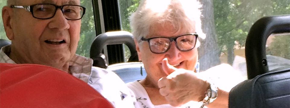 A senior gives a thumbs up from inside an STC bus.