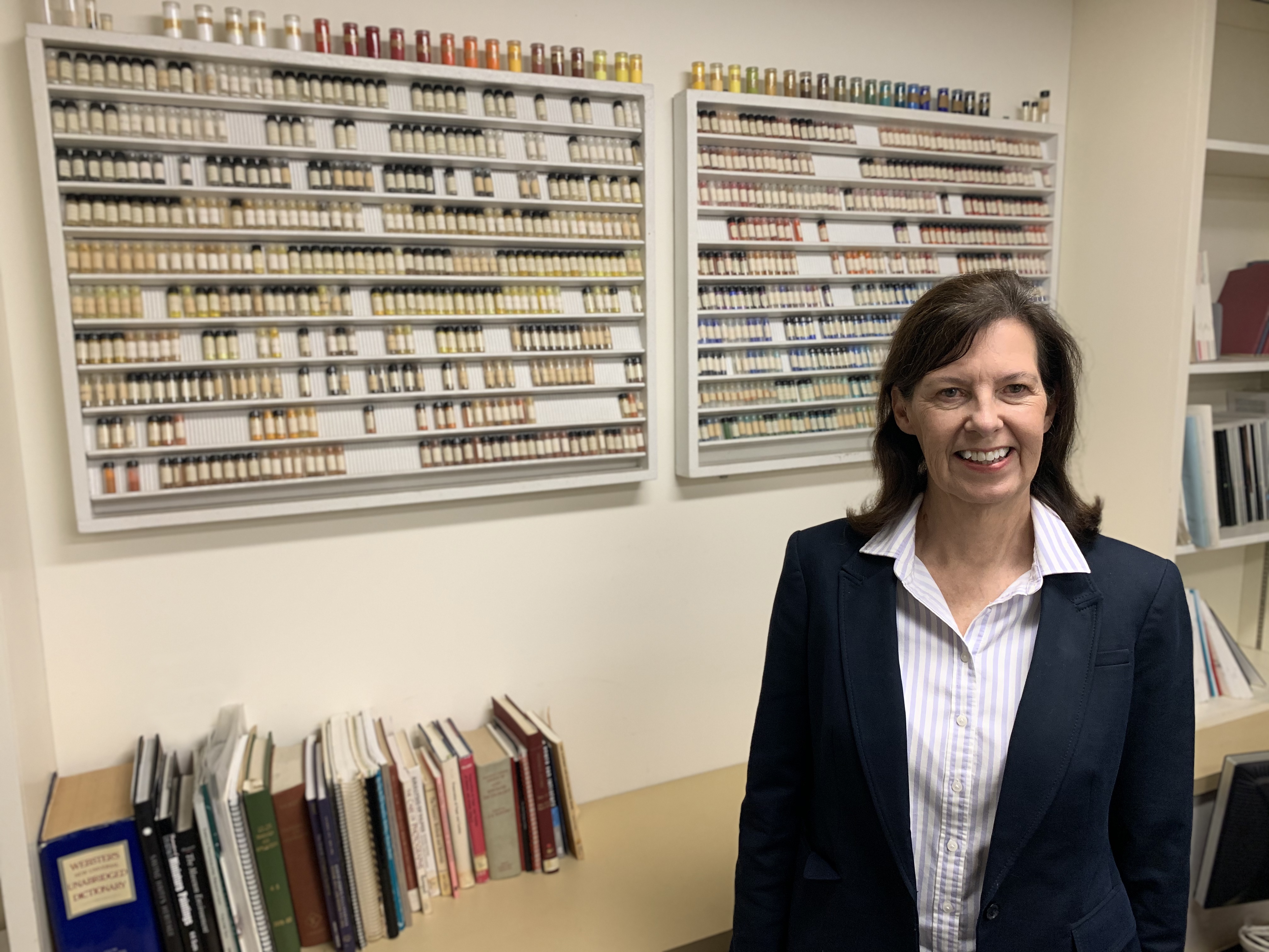 Janet Ruggles stands near a pigment collection