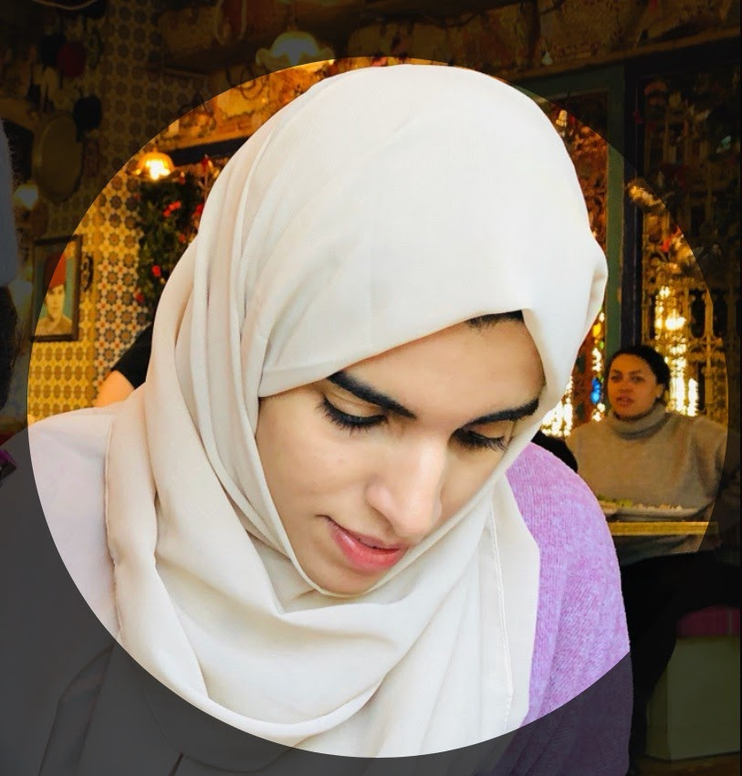 A woman wearing  a hijab looking downwards